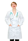Laughing doctor woman holding hands in pockets Royalty Free Stock Photo