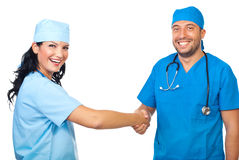 Laughing doctors shaking hands Royalty Free Stock Photo