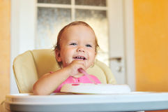 Laughing eating baby girl Royalty Free Stock Photo