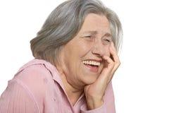 Laughing elderly woman. Isolated on white background stock image