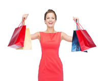 Laughing elegant woman in dress with shopping bags Stock Images
