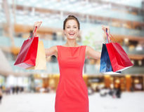 Laughing elegant woman in dress with shopping bags Stock Photos