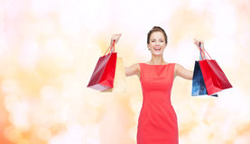 Laughing elegant woman in dress with shopping bags Royalty Free Stock Images