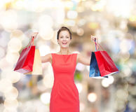 Laughing elegant woman in dress with shopping bags Stock Photo
