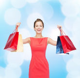 Laughing elegant woman in dress with shopping bags Royalty Free Stock Photography