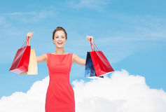 Laughing elegant woman in dress with shopping bags Royalty Free Stock Photo