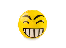 Laughing emoticon toy ball isolated over white. Stock Image