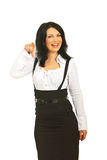 Laughing executive woman pointing you Stock Image