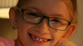 Laughing Eyeglasses Child Portrait Looking at Camera, Happy Girl Face Smiling 4K.  stock video