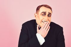 Laughing face. Comedian performer giggling. Mime artist. Mime with face paint. Man with mime makeup. Theatre actor. Miming. Stage actor miming. Theatrical royalty free stock images
