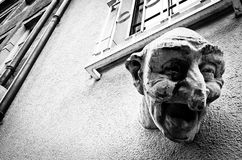 Laughing Face Sculpture, Luxembourg. A caricature sculpture of a laughing face on the side of a building in the old town of Luxembourg stock photo