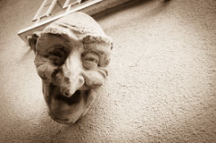 Laughing Face Sculpture, Luxembourg. A caricature sculpture of a laughing face on the side of a building in the old town of Luxembourg stock photography