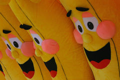 Laughing Faces. Laughing bananas awarded as prize at county fair Stock Photos