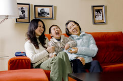 Laughing family. Picture of a happy asian family, a little boy, his mother and grandmother, laughing together Stock Image