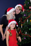 Laughing family. Under christmas tree Royalty Free Stock Photography