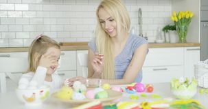 Laughing family coloring eggs stock video