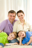 Laughing a family of four Royalty Free Stock Images