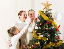 Laughing family preparing for Christmas Royalty Free Stock Image