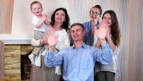 Laughing family waving their hands, all family members are having good time together, family idyll stock video