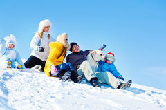 Laughing family in winter park. Laughing family and Labrador Retriever dog in winter park Stock Image