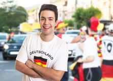 Laughing fan in german jersey with other fans Stock Photos