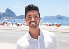 Laughing fashionable guy at Rio de Janeiro Stock Photos