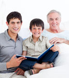Laughing father and son visiting grandfather Stock Images