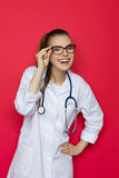 Laughing Female Doctor On Red Background Royalty Free Stock Photos
