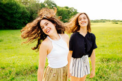 Laughing female friends moving hair Royalty Free Stock Images
