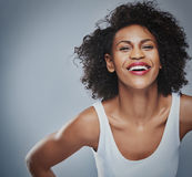 Laughing female leaning forward with copy space stock image