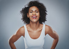 Laughing female leaning forward Royalty Free Stock Photos