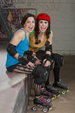 Laughing Female Roller Derby Skaters Stock Photos