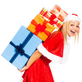 Laughing female Santa with Christmas gifts Stock Photo