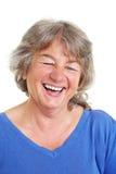 Laughing female senior citizen royalty free stock photo