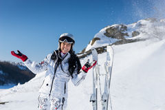 Laughing female skier in spray of snow Stock Photo