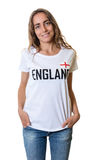 Laughing female sports fan from England. On an isolated white background for cut out Stock Image