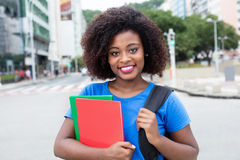 Laughing female student from Africa in blue shirt in city Royalty Free Stock Image