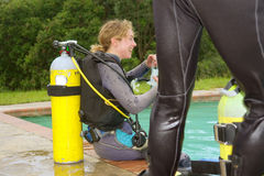 Laughing female student in divers training pool Royalty Free Stock Image