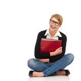 Laughing female student sitting with crossed legs. Stock Photos