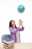 Laughing female student throwing globe into air Stock Photos