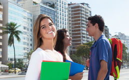 Laughing female student with two friends stock photography