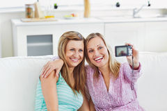 Laughing female women doing pictures of themselves Royalty Free Stock Image