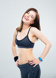 Laughing fitness woman standing over gray background Royalty Free Stock Photo