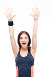 Laughing fitness woman standing with raised hands up. Isolated on a white background. Looking at camera Royalty Free Stock Photos
