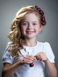 Laughing freckled girl posing with cherries Stock Photos
