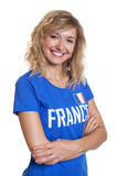Laughing french sports with blond hair and blue jersey Stock Photo