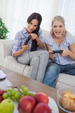 Laughing friends playing video games Stock Images