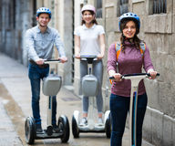 Laughing friends posing on segways in vacation Stock Photography