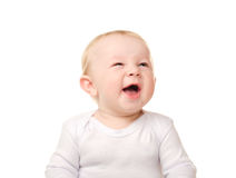 Laughing funny baby boy in white. Portrait of laughing funny baby boy isolated on white background Royalty Free Stock Image