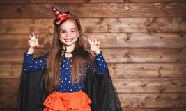 Funny child girl in witch costume in halloween Stock Photos